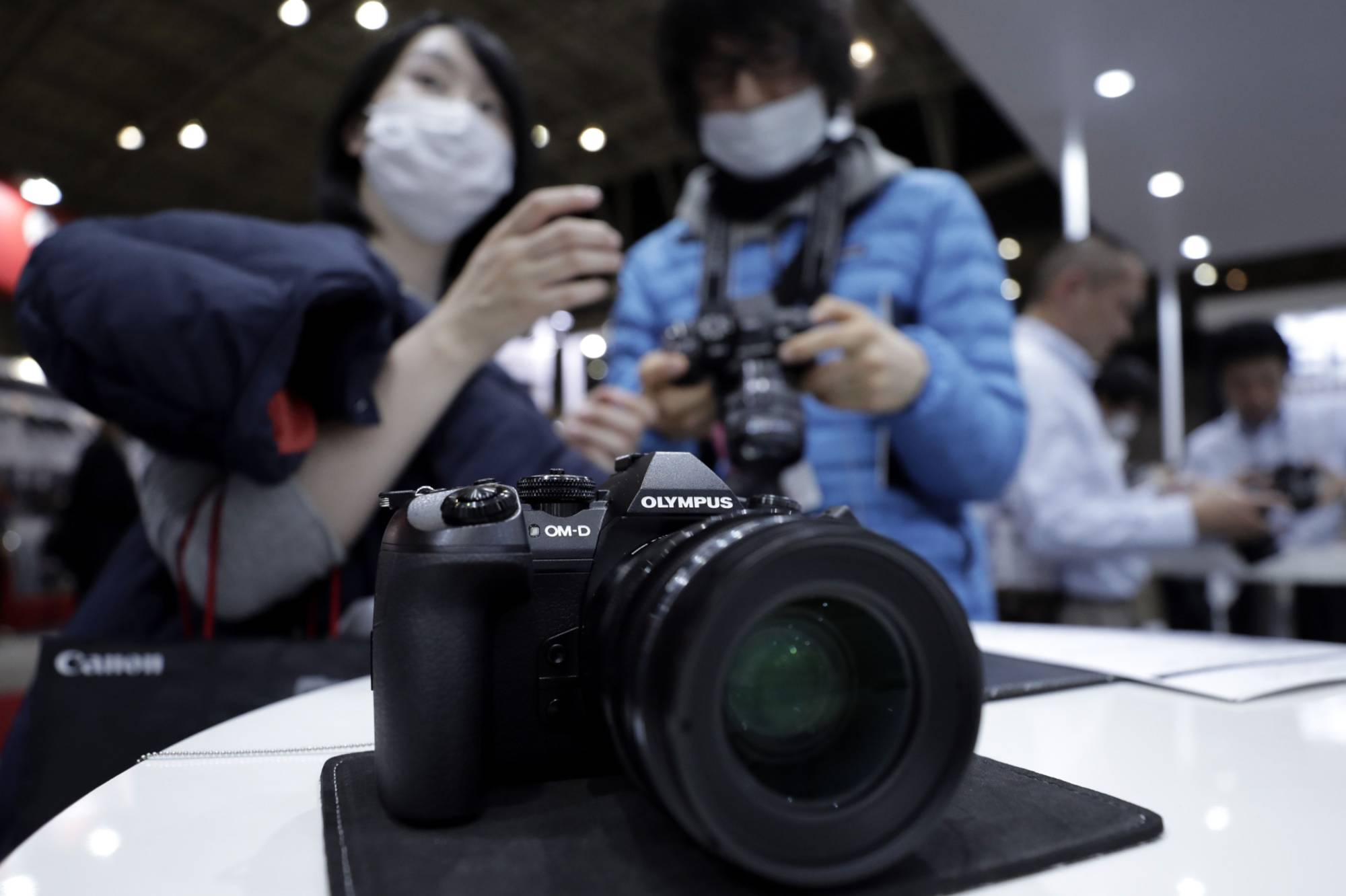 Olympus Corp.'s decision to sell its digital camera business is a harsh reminder that the market Japanese makers dominate is in a dire situation. | BLOOMBERG