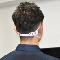 Galleria International Co. produces a plastic mask band which helps cut down on instances of sore ears caused by the elastic loops on face masks.   KYODO