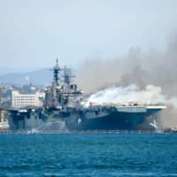 Port of San Diego Harbor Police Department boats combat a fire on board the U.S. Navy amphibious assault ship USS Bonhomme Richard at Naval Base San Diego on Sunday. | U.S. NAVY / VIA REUTERS