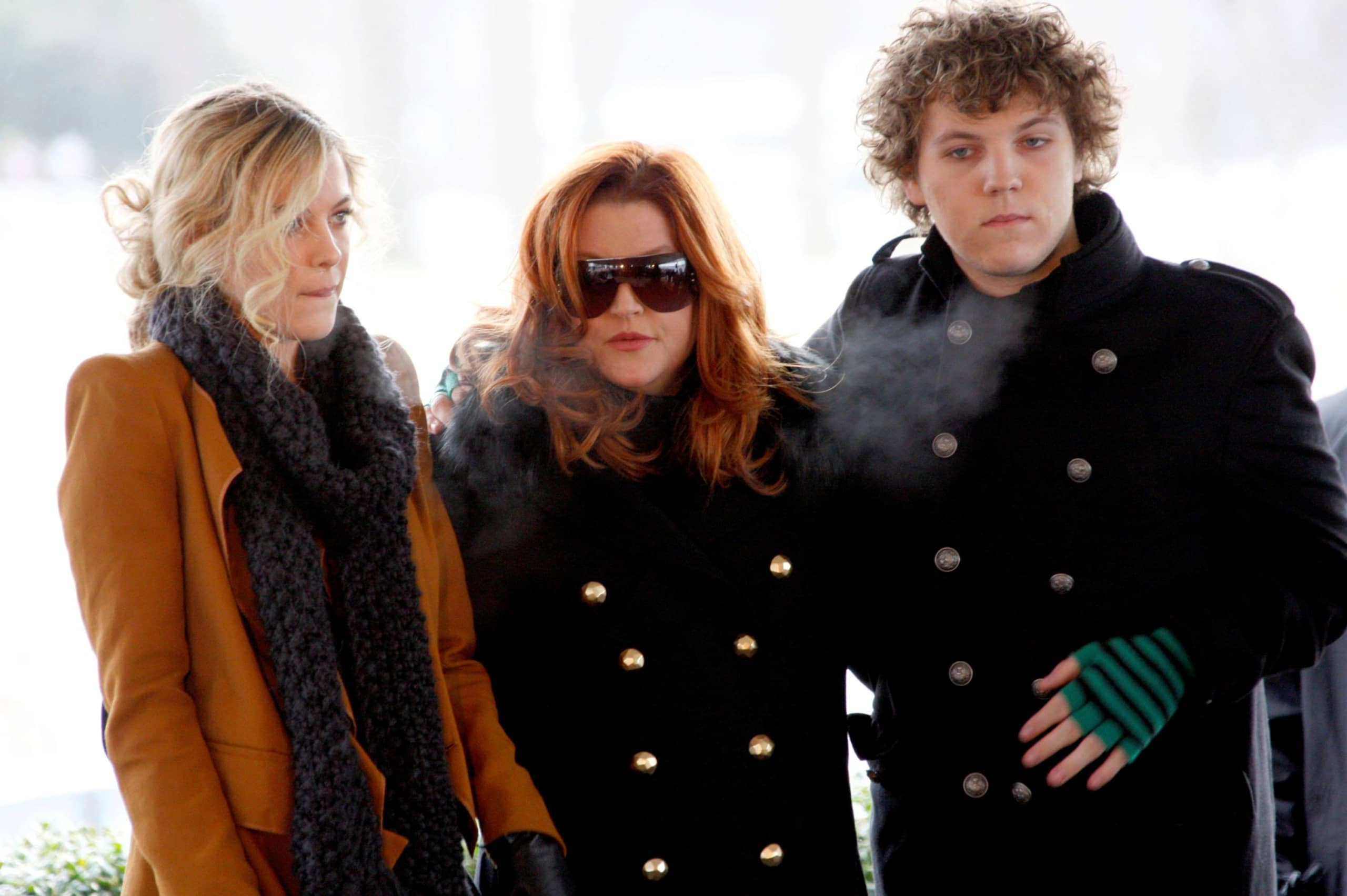 Lisa Marie Presley, with her children Riley and Benjamin Keough (right), attend the 75th birthday celebration for Elvis Presley in Memphis, Tennessee, on Jan. 8, 2010.   | REUTERS