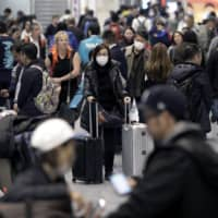 An arrival hall at Narita Airport in Chiba Prefecture. Currently, foreign residents are not allowed to re-enter Japan after visiting a country or region subject to Tokyo's coronavirus travel ban, even if they have family residing in Japan. | BLOOMBERG