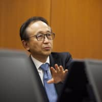 Hironori Kamezawa, chief executive officer of Mitsubishi UFJ Financial Group Inc., speaks during an interview at the company's headquarters in Tokyo on Wednesday.   BLOOMBERG