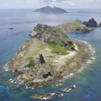 Japan's annual defense white paper accuses China of pushing its territorial claims amid the coronavirus pandemic. | KYODO