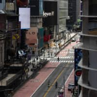 A nearly empty street is seen in Times Square on June 11, days after New York City's lockdown eased. New research shows that economic losses have come mainly from fear, not government mandates.  | BLOOMBERG