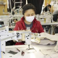 A Chinese trainee works at a sewing factory in Gifu Prefecture. The government has said it will support foreign trainees who lost their jobs due to coronavirus pandemic. | KYODO