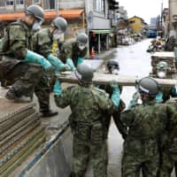 Blocked or collapsed roads, coupled with overflowing rivers, power outages and closely packed buildings, could make rescue difficult if a disaster hit Tokyo. | KYODO