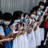 Students at a pro-democracy protest in Hong Kong in June. A new security law has sent a chill through schools and universities, with teachers fearful the city's reputation for academic freedom and excellence is now at risk.  | AFP-JIJI