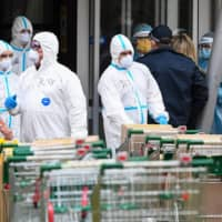 Parts of the Australian city of Melbourne have been closed off in recent weeks after COVID-19 cases spiked, leaving some trapped residents dependent on food deliveries. | AFP-JIJI