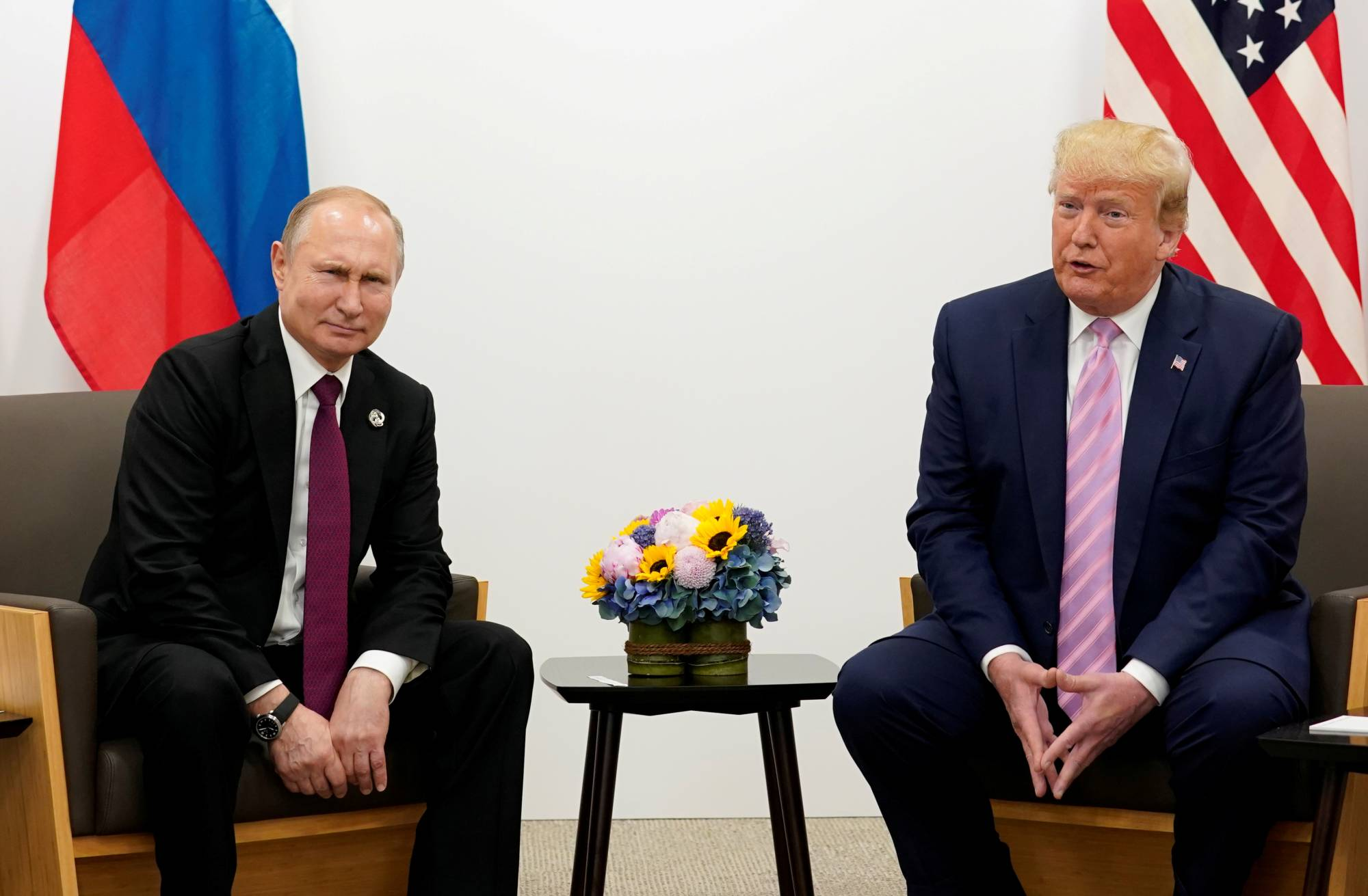 Critics consider U.S. President Donald Trump and his Russian counterpart Vladimir Putin to be populist and divisive. | REUTERS