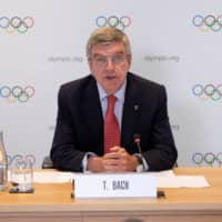 IOC President Thomas Bach speaks during a news conference in Geneva on Wednesday. | IOC / GREG MARTIN / HANDOUT VIA REUTERS