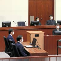 Tokyo District Court judges began wearing face masks after the outbreak of COVID-19.   KYODO