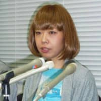 Megumi Igarashi, an artist who goes by 'Rokudenashiko' ('Good-for-nothing girl'), speaks to reporters in Tokyo in July 2014 following her release from a police cell after being arrested on obscenity charges.   KYODO