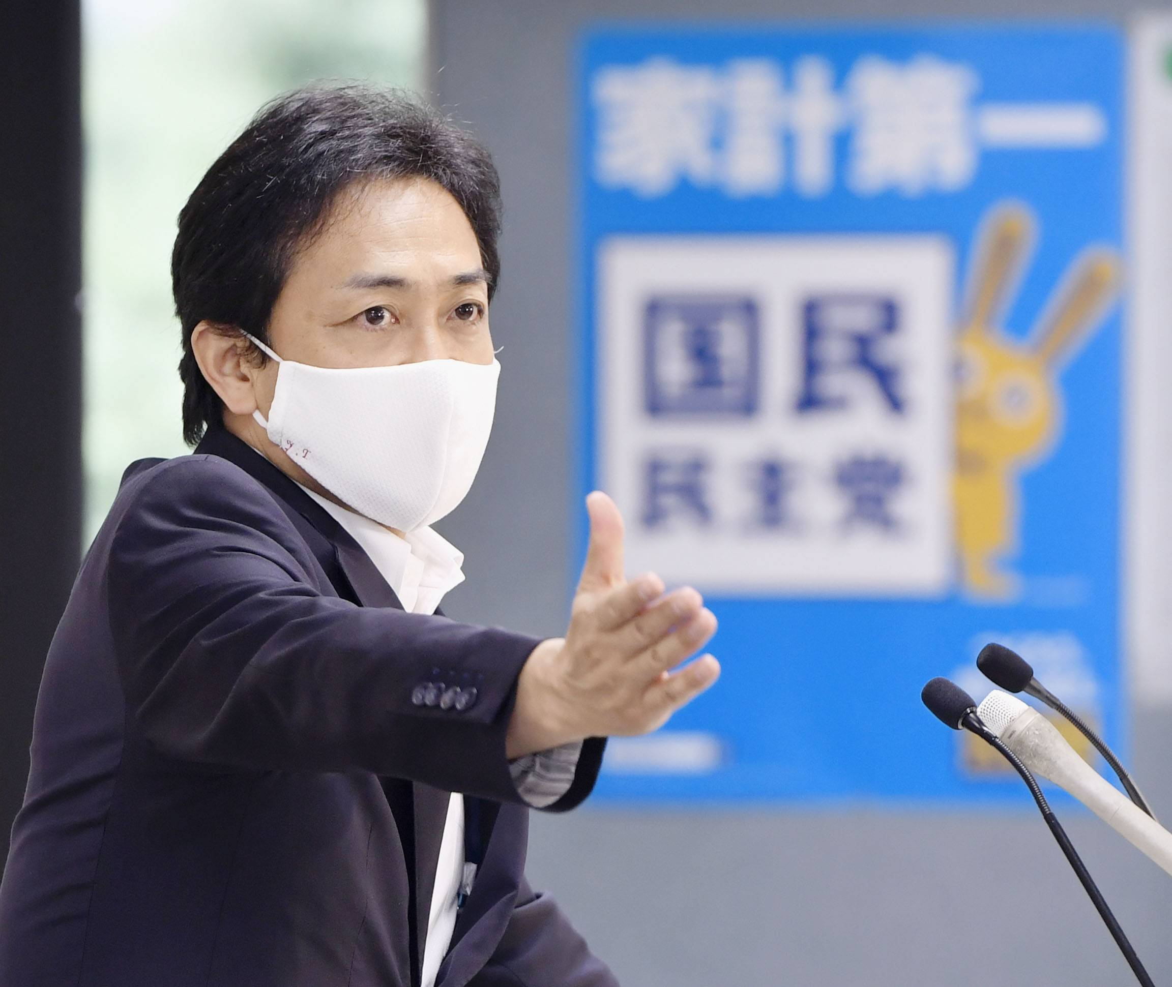 Democratic Party for the People leader Yuichiro Tamaki attends a news conference at the party's headquarters in Tokyo on Thursday. | KYODO
