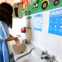 As tens of millions of people return to public transit, their workplaces and schools, are interventions such as masks and hand-washing enough? | AFP-JIJI
