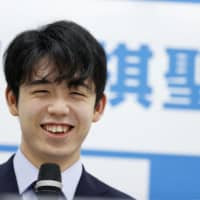Sota Fujii speaks at a news conference in Osaka Friday, a day after becoming the youngest shogi player ever to win one of the board game's eight major titles. | KYODO