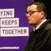 Australia's Victoria state premier Daniel Andrews speaks during a news conference in Melbourne on Wednesday. More than five million residents in the Melbourne region were ordered into a six-week lockdown last week in an effort to curb the outbreak.     AFP-JIJI