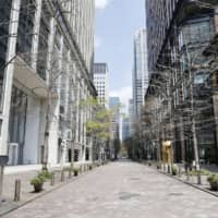 A street in the Marunouchi business district of Tokyo, where many foreign business people work and do business, stands empty amid the COVID-19 pandemic. | KYODO