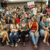 On Wednesday, a group in Provo, Utah protesting against face masks being required in schools removed the social distancing tape on the chairs and filled the Utah County Commission room to over flowing, prompting Commissioner Tanner Ainge to call for a vote to adjourn the meeting.   AP
