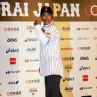 Atsunori Inaba poses for photos during a Toyko news conference introducing him as the new manager of Samurai Japan on July 31, 2017.  | KAZ NAGATSUKA