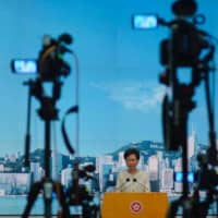 Hong Kong leader Carrie Lam, asked if she could 'guarantee' media freedoms after the enforcement a new national security law, said she could if reporters 'guarantee that they will not commit any offenses under' the law.  | AP