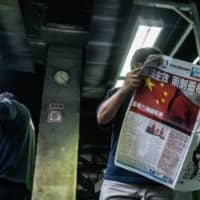 Immediately after the security law was passed, two columnists quit the city's rambunctious Apple Daily newspaper, a staunch advocate for greater democracy. | BLOOMBERG