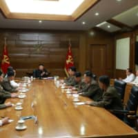 North Korean leader Kim Jong Un guides a Central Military Commission meeting in this photo released Sunday.  | KCNA / VIA REUTERS