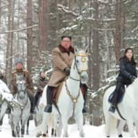 North Korean leader Kim Jong Un rides a horse as he visits battle sites in the area of Mount Paektu in Ryanggang, North Korea, in this picture released in December. | KCNA / VIA REUTERS