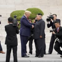 U.S. President Donald Trump meets with North Korean leader Kim Jong Un at the Demilitarized Zone separating the two Koreas, in Panmunjom, South Korea, on June 30 last year. | REUTERS