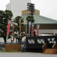 Banners bearing the names of rikishi are displayed outside Ryogoku Kokugikan on Sunday, the first day of the July Grand Sumo Tournament. | KYODO