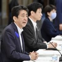 More than half of respondents in a recent opinion poll are dissatisfied with Prime Minister Shinzo Abe's response to the novel coronavirus, a survey shows. | KYODO