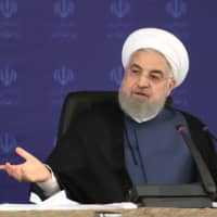 Iranian health officials play down president's figure of 25 million people infected