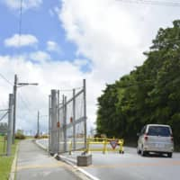 A gate is seen open at U.S. Marine Corps Air Station Futenma in Ginowan, Okinawa Prefecture, in a photo taken on July 14. | KYODO