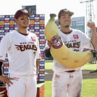 The Eagles' Hideto Asamura (left) and Yasuhito Uchida participate during the postgame hero interview on Sunday in Sendai. | KYODO