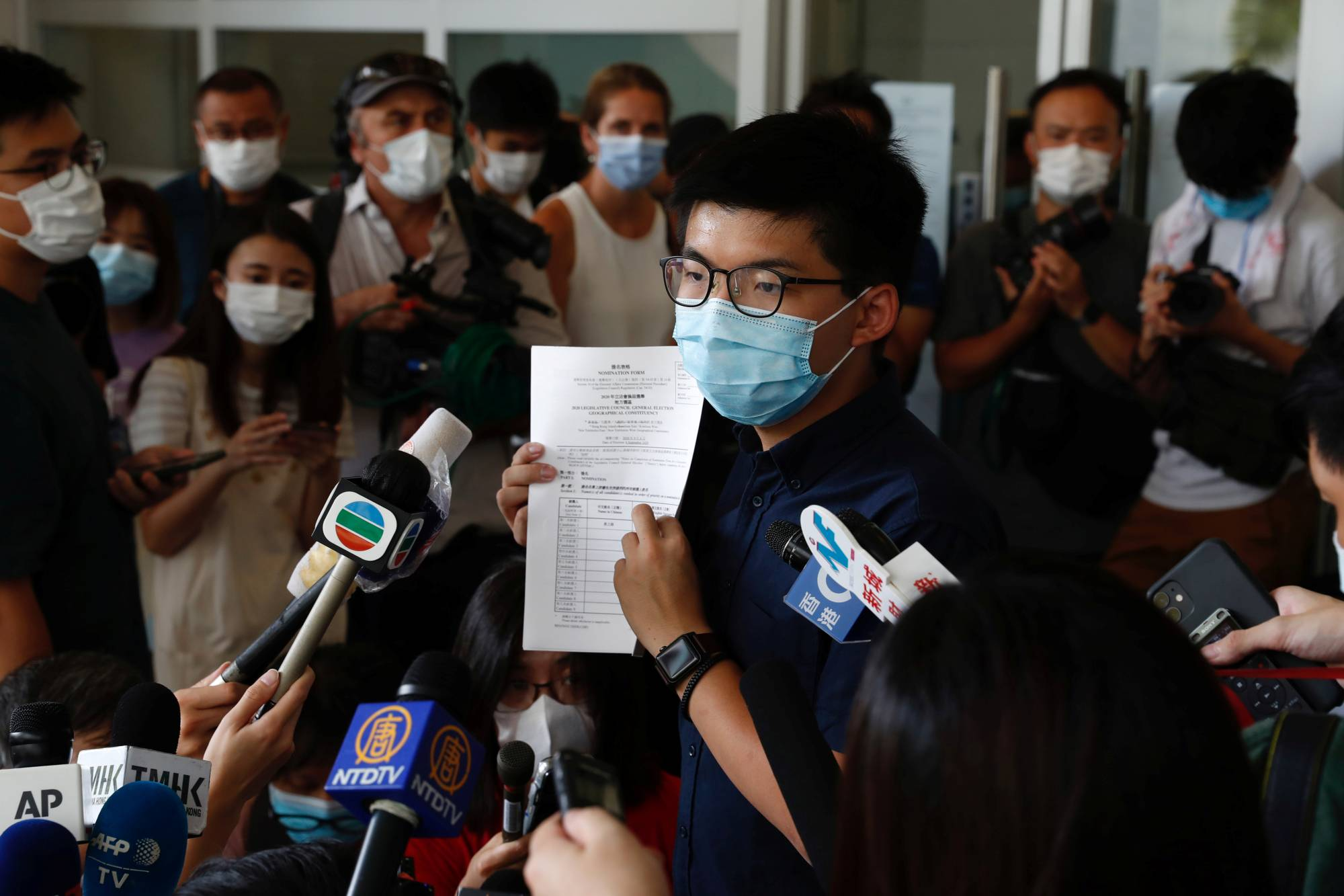 Pro-democracy activist Joshua Wong registers as a candidate for the upcoming Legislative Council election in Hong Kong on Monday.   REUTERS