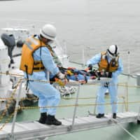 Japan Coast Guard holds rescue drill in event of virus outbreak