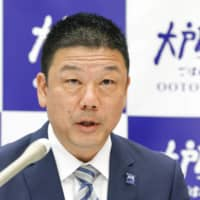 Ootoya Holdings CEO Kenichi Kubota holds a news conference in Tokyo on Monday.    KYODO