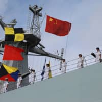 People's Liberation Army personnel set sail to set up a base in Djibouti in 2017. | REUTERS