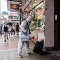 While measures are in place for dealing with certain aspects of the crisis, critics say Hong Kong's lax quarantine policy has helped COVID-19 to spread in the city. | AFP-JIJI