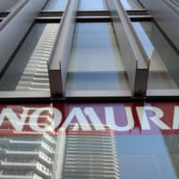 In a country where investors are used to paying commission, Nomura Holdings Inc. is looking to convince individuals to pay fees instead as it seeks to revive its retail business. A branch of the group's core brokerage, Nomura Securities Co., is seen in Kawasaki, Kanagawa Prefecture. | BLOOMBERG