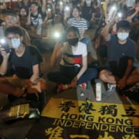 Supporters of the Hong Kong pro-democracy movement gather at Liberty Square in Taipei to mark the one-year anniversary of the start of the protests on June 13. | REUTERS