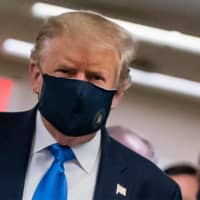 U.S. President Donald Trump wears a mask as he visits Walter Reed National Military Medical Center in Bethesda, Maryland, on  July 11. | AFP-JIJI