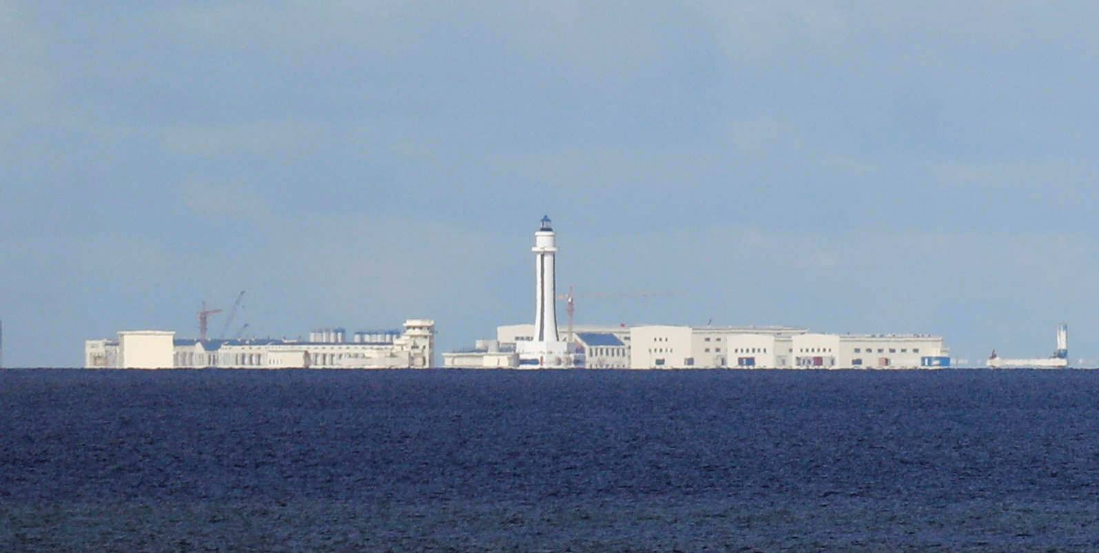 Chinese structures are pictured at the disputed Spratly Islands in the South China Sea in April 2017. After Washington last week hardened its position by explicitly rejecting Chinese maritime claims in the South China Sea, U.S. embassies in the region produced an unprecedented flurry of op-eds and statements criticizing Beijing's actions, including through social media outlets. | REUTERS