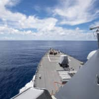 The USS Ralph Johnson operates in the Spratly Islands on July 14 during a freedom of navigation operation to uphold the rights, freedoms and lawful uses of the sea, recognized in international law, by challenging restrictions on innocent passage imposed by China, Vietnam and Taiwan. | U.S. NAVY