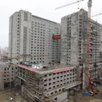 This undated picture released from North Korea's official Korean Central News Agency on Monday shows the Pyongyang General Hospital under construction. | KCNA / KNS / VIA AFP-JIJI