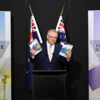 Australian Prime Minister Scott Morrison speaks at the Australian Defence Force Academy on July 1 during the launch of the 2020 DefenceStrategic Update in the wake of cyberattacks targeting Australia. | APP / VIA REUTERS