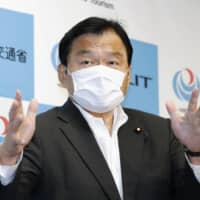 Tourism minister Kazuyoshi Akaba speaks during a news conference Tuesday in Tokyo. | KYODO
