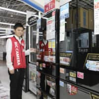 Refrigerators are displayed at a store in the Shinjuku district of central Tokyo.   KYODO