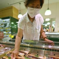 Eel is on sale at a supermarket in Tokyo on Tuesday, the Day of the Ox, when eel is traditionally eaten in Japan. | KYODO