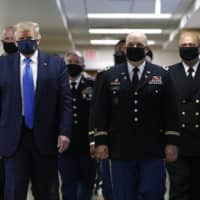 U.S. President Donald Trump wears a face mask for the first time in public during the pandemic on July 11 at a military hospital in Maryland.  | AP