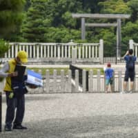 Few visitors are seen at a World Heritage-designated keyhole-shaped mound named after Emperor Nintoku, who is said to have reigned in the fourth century, in Sakai, Osaka Prefecture, earlier this month. | KYODO